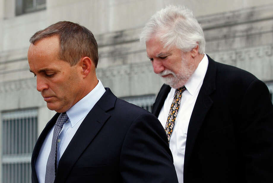 Andrew Young, former aide to former U.S. Sen. and presidential candidate John Edwards, leaves federal court with attorney David Geneson, right, in Greensboro, N.C., Monday, April 23, 2012. Prosecutors and defense lawyers began making their case to jurors on whether the former presidential candidate violated federal campaign finance laws. (AP Photo/Gerry Broome) / AP