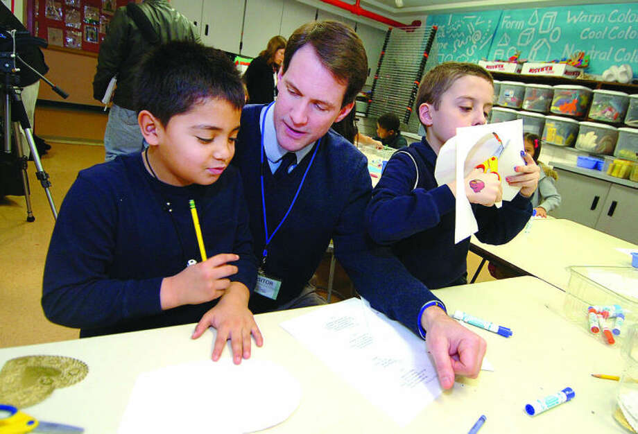 Hour Photo/ Alex von Kleydorff. L-R Anthony Argonand and Joshua Stendbergh along with Jim Himes make Valentines for Veterans at KT Murphy school in Stamford