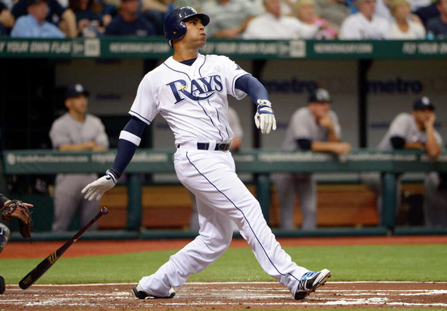 Tampa Bay Rays' Carlos Pena watches the flight of the ball after hitting a grand-slam home run during the first inning of a baseball game against the New York Yankees in St. Petersburg, Fla., Friday, April 6, 2012. (AP Photo/Phelan M. Ebenhack) / FR121174 AP