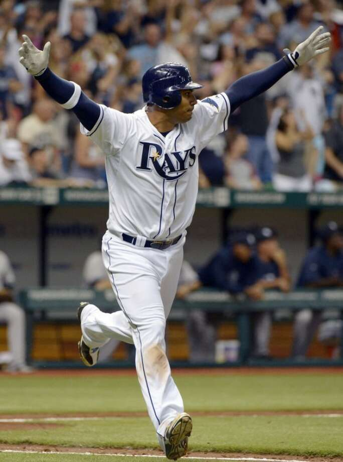 Tampa Bay Rays' Carlos Pena celebrates after hitting the game-winning RBI single in the bottom of the ninth inning for a 7-6 win over the New York Yankees in a baseball game in St. Petersburg, Fla., Friday, April 6, 2012.(AP Photo/Phelan M. Ebenhack)
