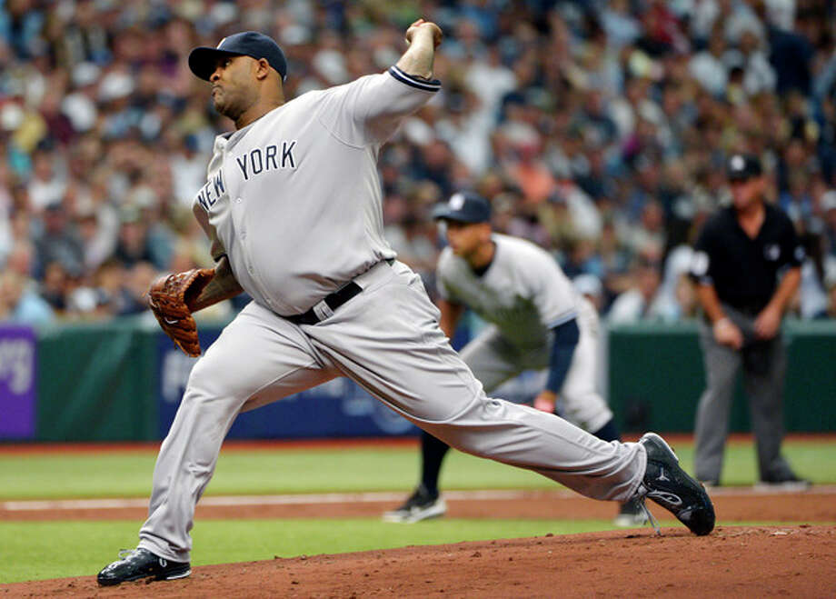 New York Yankees starting pitcher CC Sabathia throws during the first inning of a baseball game against the Tampa Bay Rays in St. Petersburg, Fla., Friday, April 6, 2012.(AP Photo/Phelan M. Ebenhack) / FR121174 AP