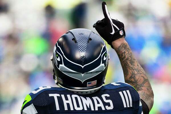 Earl Thomas extends a finger to the heavens during the first half of the NFC Championship game against the Green Bay Packers Sunday, January 18, 2015, at CenturyLink Field in Seattle, Washington. (Jordan Stead, seattlepi.com)