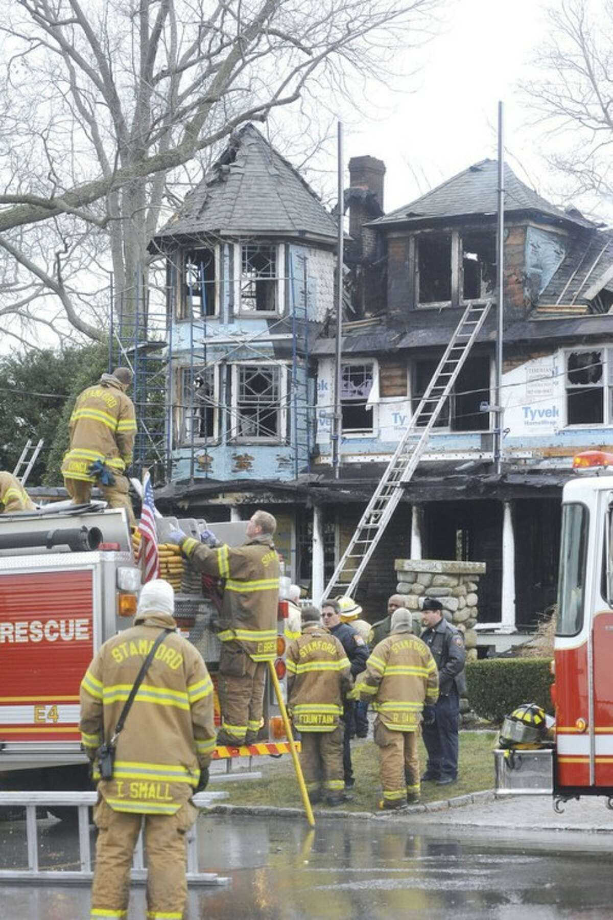 File Photo / Matthew Vinci. Stamford Fire & Rescue teams work outside of a home at 2267 Shippan Ave. in Stamford after a fire broke out Christmas Day 2011, killing five occupants.