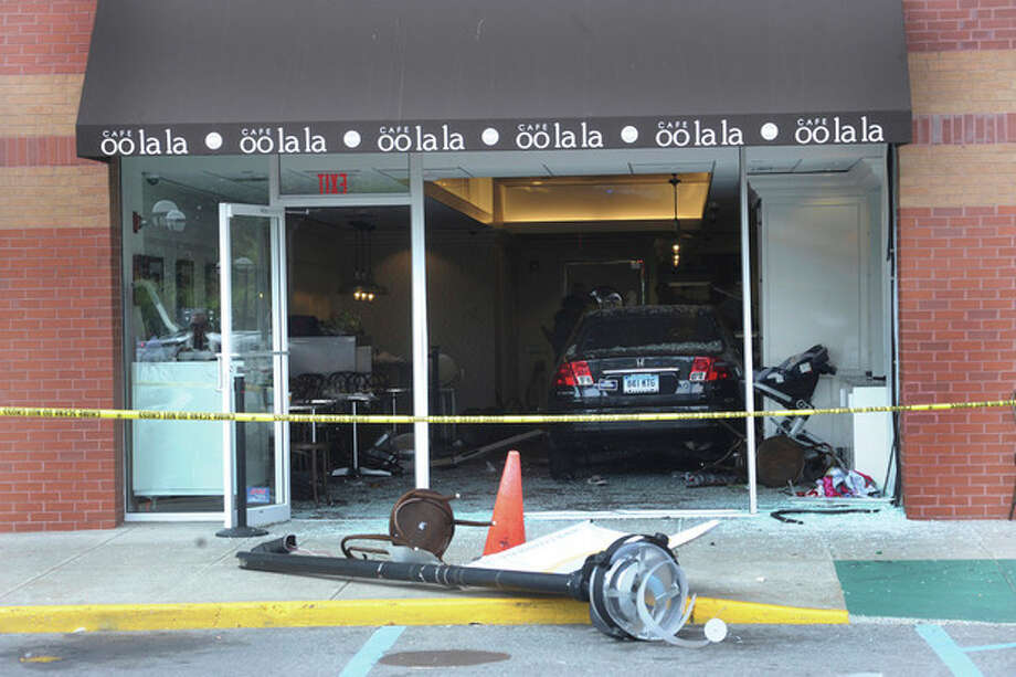A car went through the window into Cafe oo la la at the Ridgeway Plaza in Stamford on Monday at around 1:00. hour photo/matthew vinci / (C)2011, The Hour Newspapers, all rights reserved