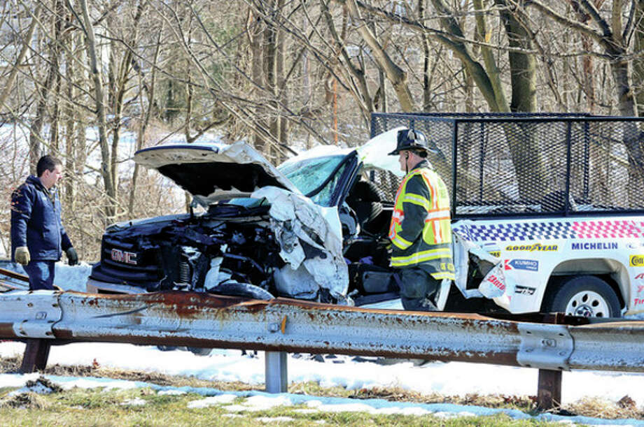 An autoparts truck rolled over during a multi-vehicle accident on the Merritt Parkway at exit 40 closing down northbound traffic for nearly an hour Thursday.Hour photo / Erik Trautmann / (C)2012, The Hour Newspapers, all rights reserved