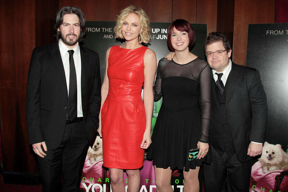 "Director Jason Reitman, from left, actress, Charlize Theron, writer Diablo Cody and actor Patton Oswalt attend the premiere of ""Young Adult,"" Thursday, Dec. 8, 2011 at the Ziegfeld Theatre in New York. (AP Photo/Starpix, Dave Allocca) / StarPix©2011"