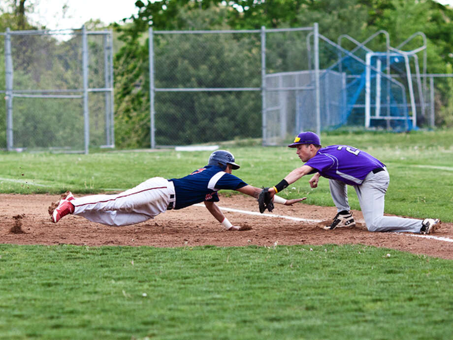 BMHS #2 dives back to safety after taking a long lead in hopes of stealing second base. DAVID ESPOSITO / Hour photo / LUCIO Photography