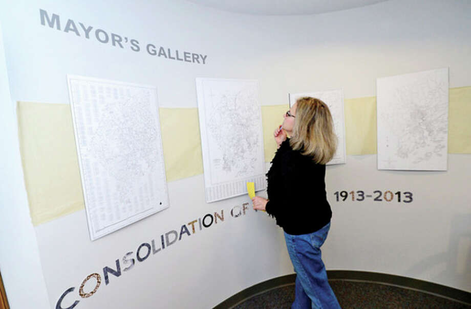"Norwalk Historical Commissioner Holly Cuzzone attends the opening reception for the exhibit, ""Consolidation of Norwalk 1913-2013"" at the Mayor's Gallery Friday in Norwalk City Hall.Hour photo / Erik Trautmann / (C)2012, The Hour Newspapers, all rights reserved"