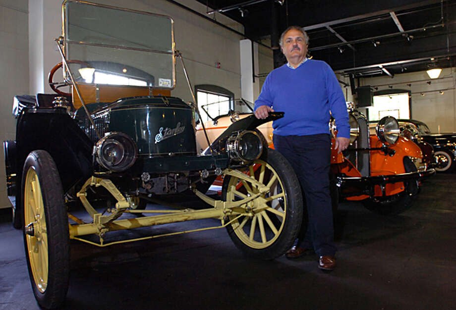 Manny Dragone introduces the 1911 Satnley Steamer that will be one of the 50 cars featured at the Dragone Classic Car Auction May 15th. Hour photo / Erik Trautmann / (C)2011, The Hour Newspapers, all rights reserved
