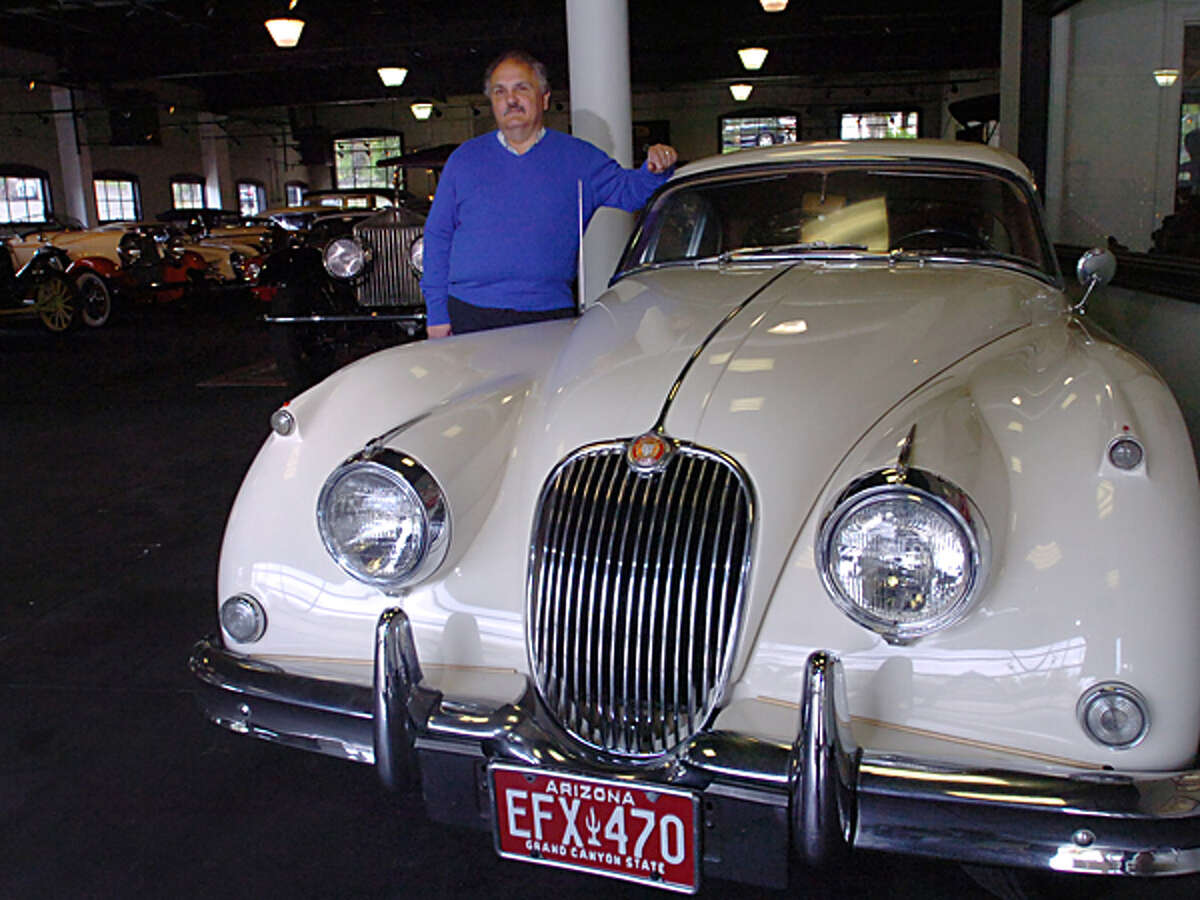 Manny Dragone introduces the 1960 Jaquar 150 Coupe that will be one of the 50 cars featured at the Dragone Classic Car Auction May 15th. Hour photo / Erik Trautmann