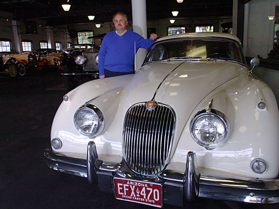 Manny Dragone introduces the 1960 Jaquar 150 Coupe that will be one of the 50 cars featured at the Dragone Classic Car Auction May 15th. Hour photo / Erik Trautmann / (C)2011, The Hour Newspapers, all rights reserved