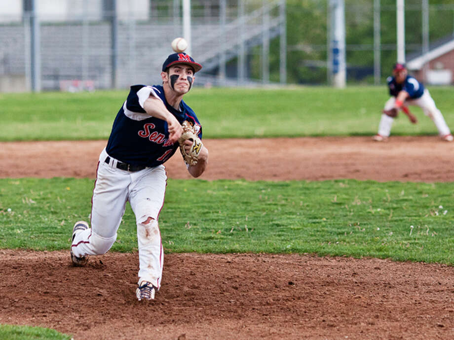 BMHS pitcher #11 delivers a strong, accurate pitch during a game against West Hill Wednesday evening. DAVID ESPOSITO / Hour photo / LUCIO Photography
