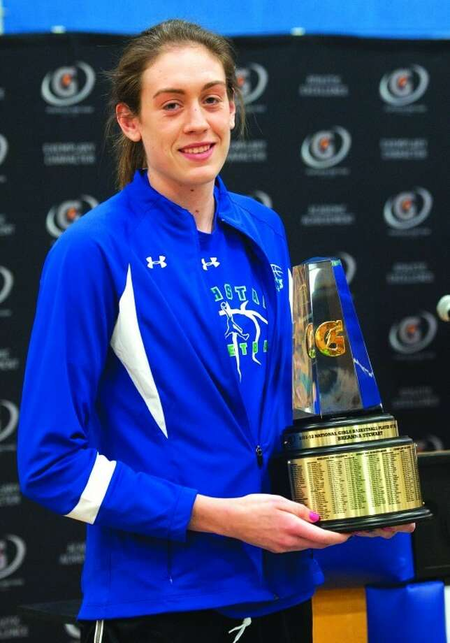 Breanna Stewart, of Cicero-North Syracuse High School holds the trophy after being named the Gatorade National Girls Basketball Player of the Year, Thursday, March 15, 2012 in Cicero, N.Y. (AP Photo/Gatorade, Susan Goldman)