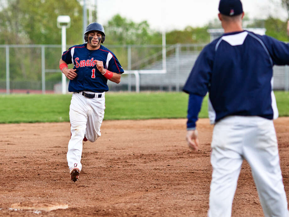 BMHS #1 rounds 3rd base while playing agains West Hill Wednesday evening. DAVID ESPOSITO / Hour photo / LUCIO Photography