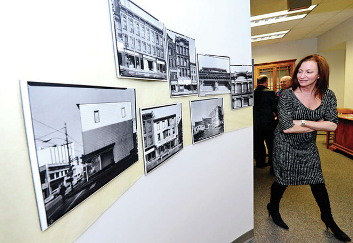 """Norwalk Administrative Servivces Manger Kathryn Hebert attends the opening reception for the exhibit, """"Consolidation of Norwalk 1913-2013"""" at the Mayor's Gallery Friday in Norwalk City Hall. Hour photo / Erik Trautmann"""