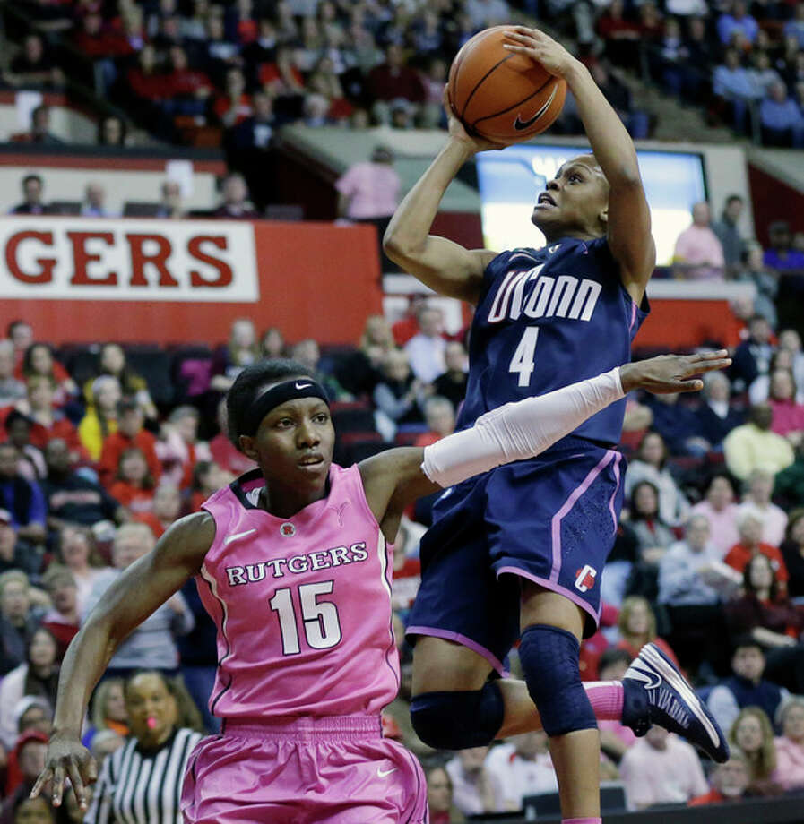 Connecticut's Moriah Jefferson (4) takes a shot over Rutgers' Syessence Davis (15) during the first half of an NCAA college basketball game Saturday, Feb. 16, 2013, in Piscataway, N.J. (AP Photo/Mel Evans) / AP