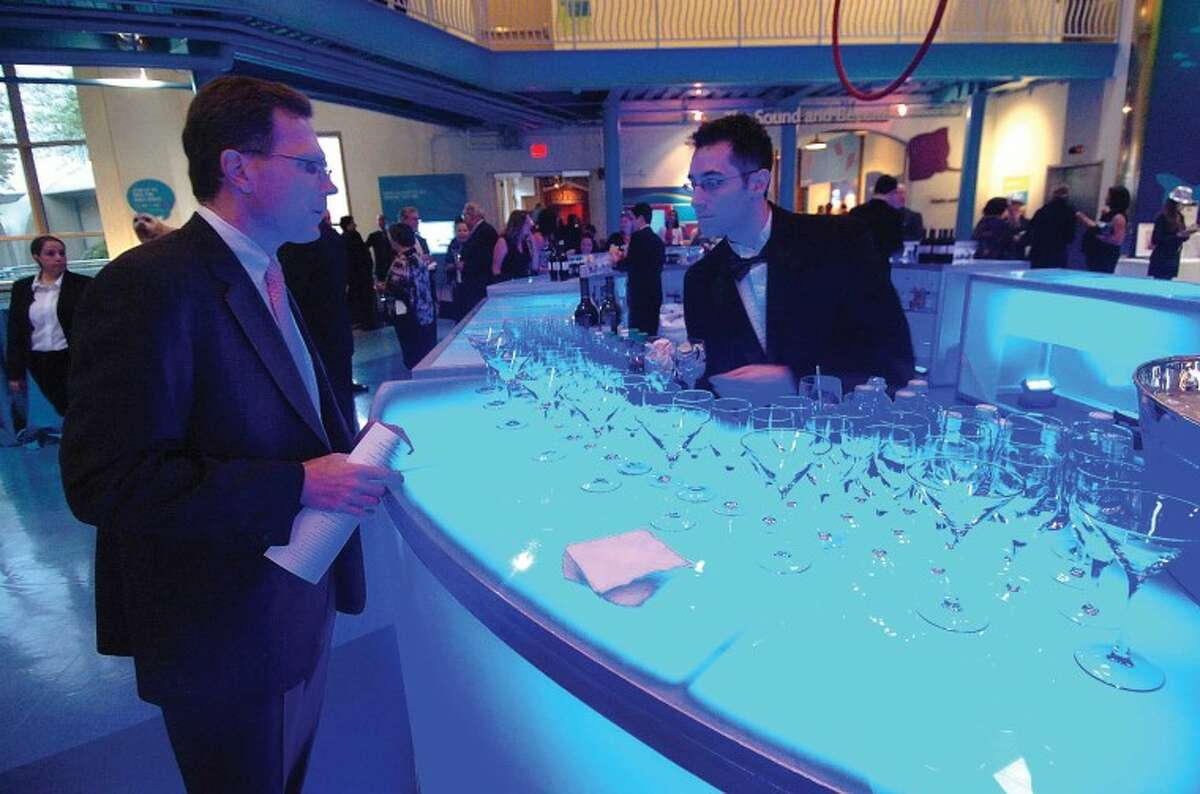 Hour Photo/ Alex von Kleydorff. The Martini bar bathed in bue light at the Red Apple Gala