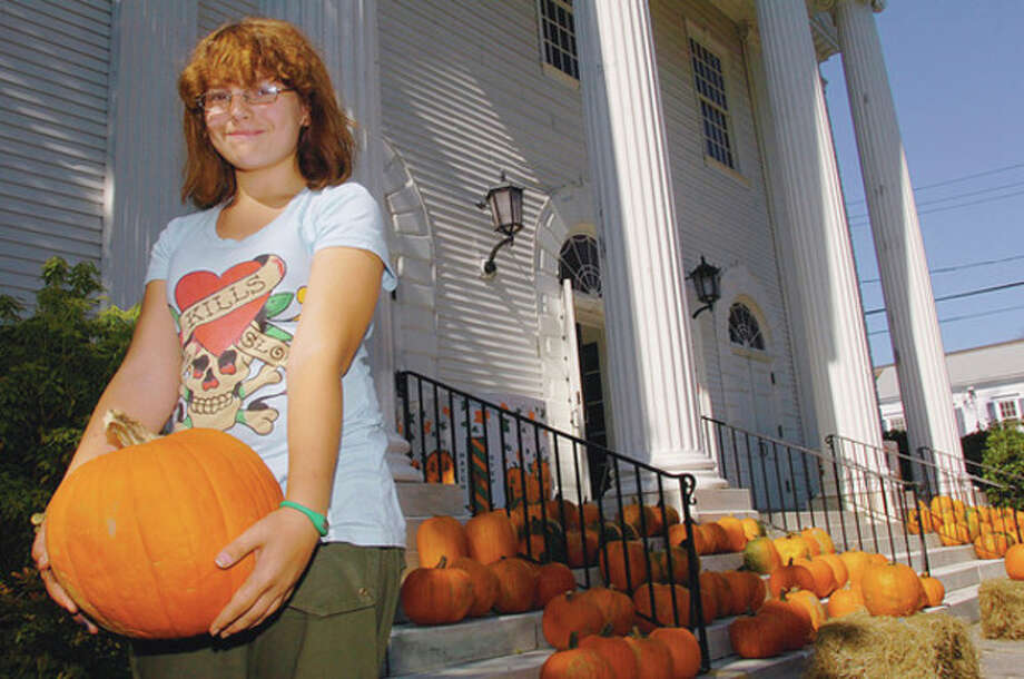 Hour photo / Erik Trautmann Brianne Curran picks out a pumpkin at the First Congregational Church Pumpkin Sale Saturday. / (C)2011, The Hour Newspapers, all rights reserved