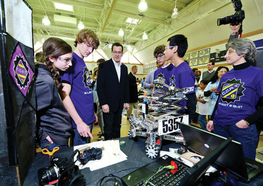 CT Governor Danell Malloy chats with the the Chase Collegiate team from Waterbury as they join students 28 robotics teams from schools in Connecticut, New York, New Jersey and Rhode Island and compete in Connecticut's FIRST® Tech Challenge (FTC) State Championship Tournament on Saturday at Greens Farms Academy in Westport.Hour photo / Erik Trautmann / (C)2012, The Hour Newspapers, all rights reserved