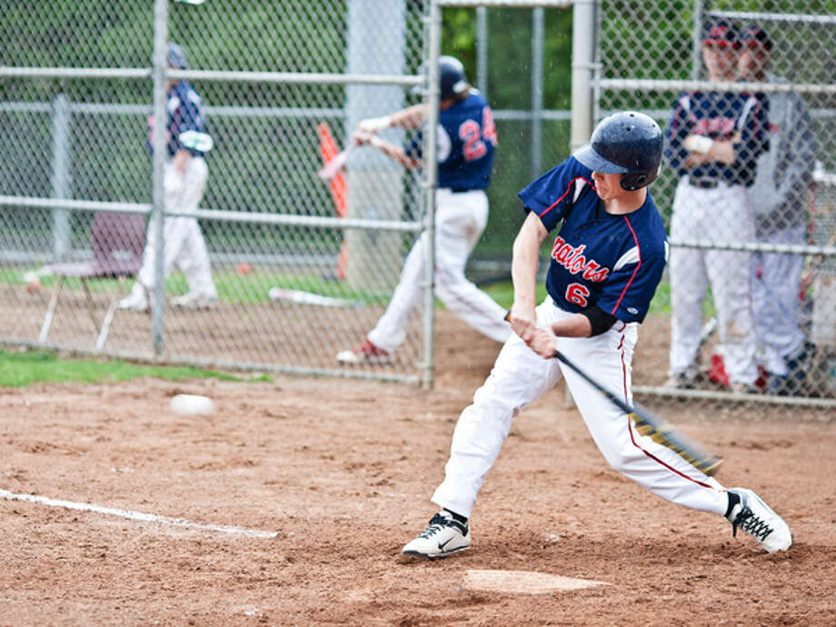 BMHS #6 connects and sends a shot out to center field. DAVID ESPOSITO / Hour photo / LUCIO Photography
