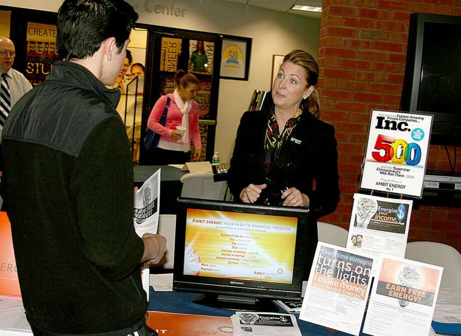 Photo by Chris Bosak Tracey Stetler of AmbitEnergy talks about her company during a Job and Career Expo held Thursday at Norwalk Community College.