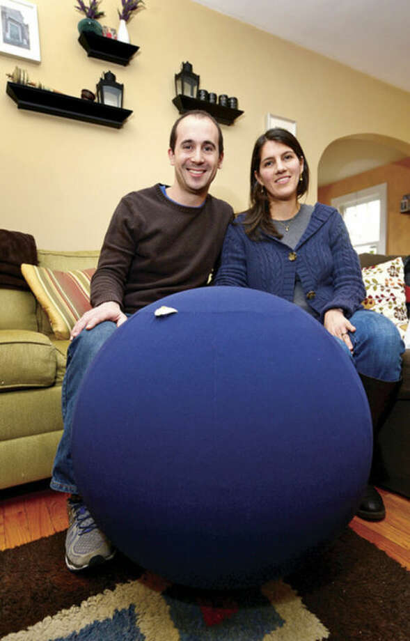 Norwalk resident Ben Peck and his wife Jelueh have designed the PilaSit, a fitness ball with a high quality and fashionable weighted fabric cover.Hour photo / Erik Trautmann