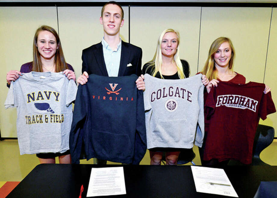 Hour photo/Erik TrautmannAnother quartet of Staples athletes made their college destinations known Friday. Those who have signed their letters of intent to attend Division I schools are, from left, Emily Troelstra (track), Henry Wynne (track), Ryan Kirschner (girls lacrosse) and Turner Block (girls soccer). / (C)2012, The Hour Newspapers, all rights reserved