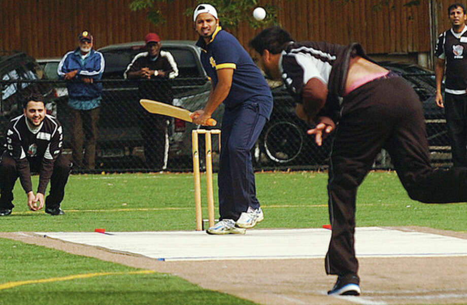 Hour photo / Erik Trautmann. John Master waits for the pitch during a charity cricket match in Stamford on Saturday. / (C)2011, The Hour Newspapers, all rights reserved
