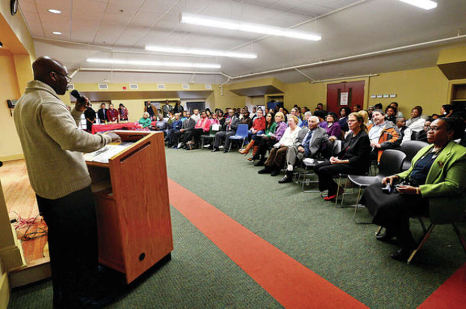 Ted Browm remarks on the life of his mother Beatrice Brown as the The South Norwalk Branch Library celebrates Black History Month this year by honoring five Norwalk African-American men and women including Bea Brown Saturday afternoon.Hour photo / Erik Trautmann / (C)2012, The Hour Newspapers, all rights reserved