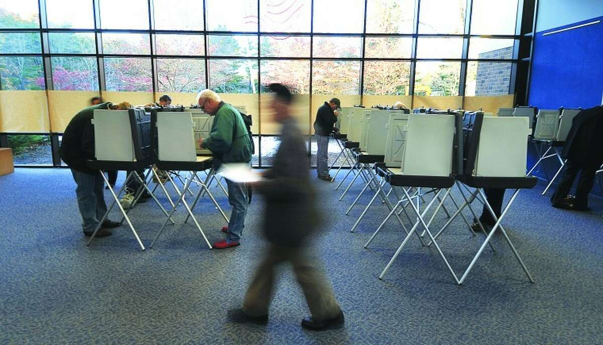 File Photo/Alex von Kleydorff. Voting at Wilton's District 1 polling center, the Clune Center for the Performing Arts.