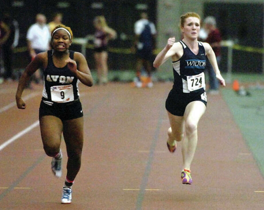 Hour photo/Alex von KleydorffWilton's Shannon Quinlan, right, competes in the 55-meter dash during Friday's Class L state championship meet in New Haven. Quinlan finished seventh in the event and was second in the 300, helping the Warriors to second place in the team standings. / 2013 The Hour Newspapers