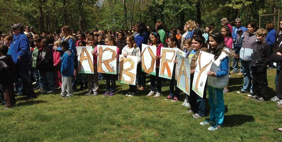 Hour Photo/ Alex von Kleydorff. Naramake Students spell it out with letters at Arbor Day.