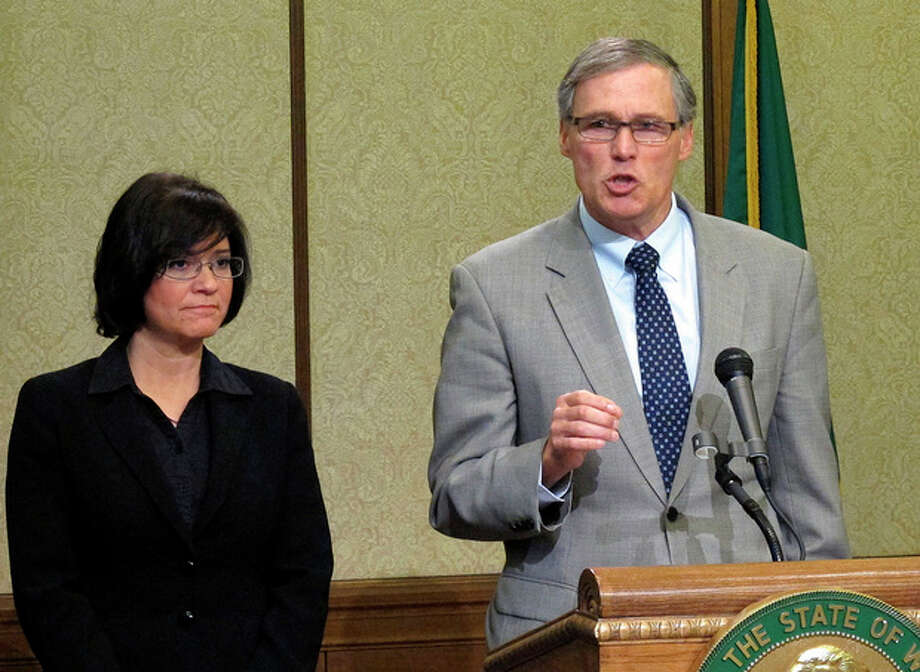 Washington state Gov. Jay Inslee, right, is joined by Maia Bellon, director of the Department of Ecology, at a news conference to discuss a tank leak at Hanford Nuclear Reservation, on Friday, Feb. 15, 2013, in Olympia, Wash. The U.S. Department of Energy said liquid levels are decreasing in one of 177 underground tanks, but that higher radiation levels have not been detected. (AP Photo/Rachel La Corte) / AP