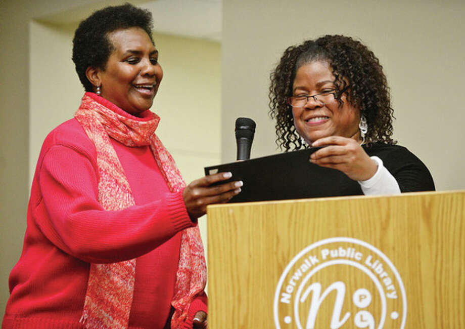 Catherine Vaughn, left, accepts a certificate from Harris honoring her father, Dr. Leroy S. Vaughn. / (C)2012, The Hour Newspapers, all rights reserved
