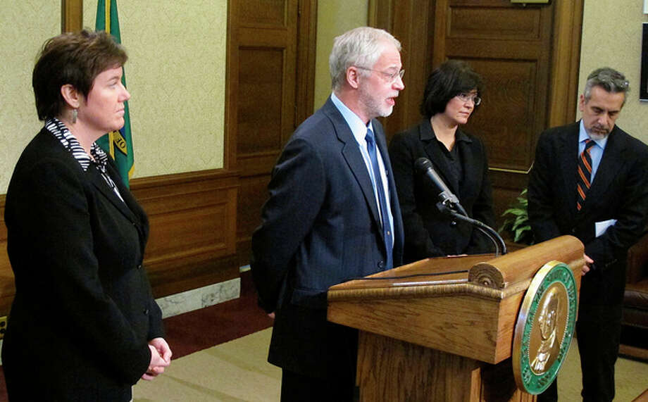 Keith Phillips, energy policy adviser to Gov. Jay Inslee, talks to the media about a tank leak at Hanford Nuclear Reservation, joined by Mary Sue Wilson from the Attorney General's Office, left, Maia Bellon, director of the Department of Ecology, second from right, and Inslee spokesman David Postman, far right, on Friday, Feb. 15, 2013, in Olympia, Wash. The U.S. Department of Energy said liquid levels are decreasing in one of 177 underground tanks, but that higher radiation levels have not been detected. (AP Photo/Rachel La Corte) / AP