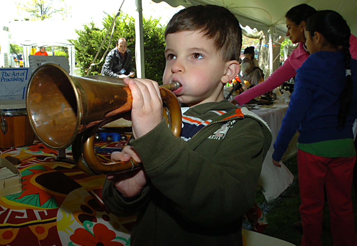 William Smith plays a bugle at the Westport Mini Maker Faire Saturday at Jesup Green in Westport where more than 50 hobbyists, scientists, students, artists and other creators showcased their wares. Hour photo / Erik Trautmann