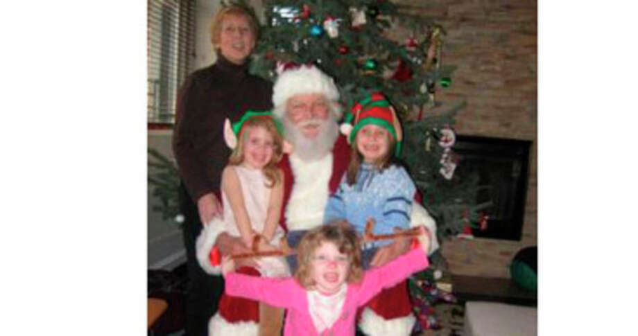 Lomer Johnson, dressed in a Santa Claus suit, his wife Pauline and their three grandchildren were killed in a Christmas morning fire in Shippan Point. Contributed photo