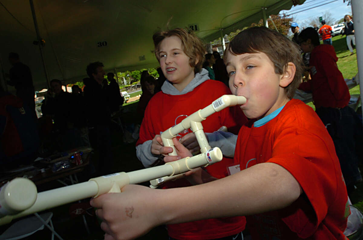 Charlie Quigley and Christian Franzese shoot a marshmellow gun at the Westport Mini Maker Faire Saturday at Jesup Green in Westport where more than 50 hobbyists, scientists, students, artists and other creators showcased their wares. Hour photo / Erik Trautmann