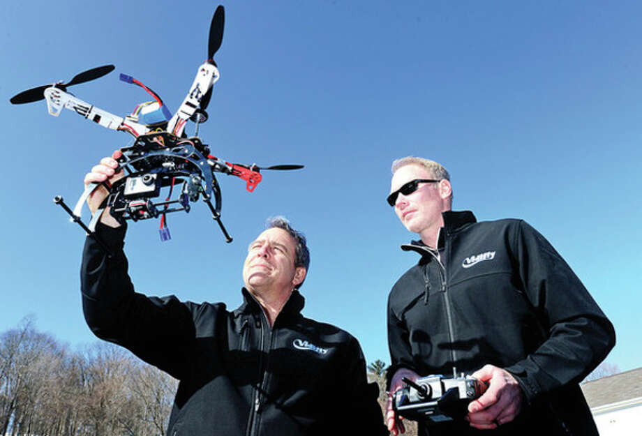"""Hour photos / Erik TrautmannAdam Pemberton and Scott Benton and their company, Vidifly, use """"drone"""" aerial helicopters to film marketing videos, a new technology that is taking off in Hollywood and the hobby industry. / (C)2012, The Hour Newspapers, all rights reserved"""