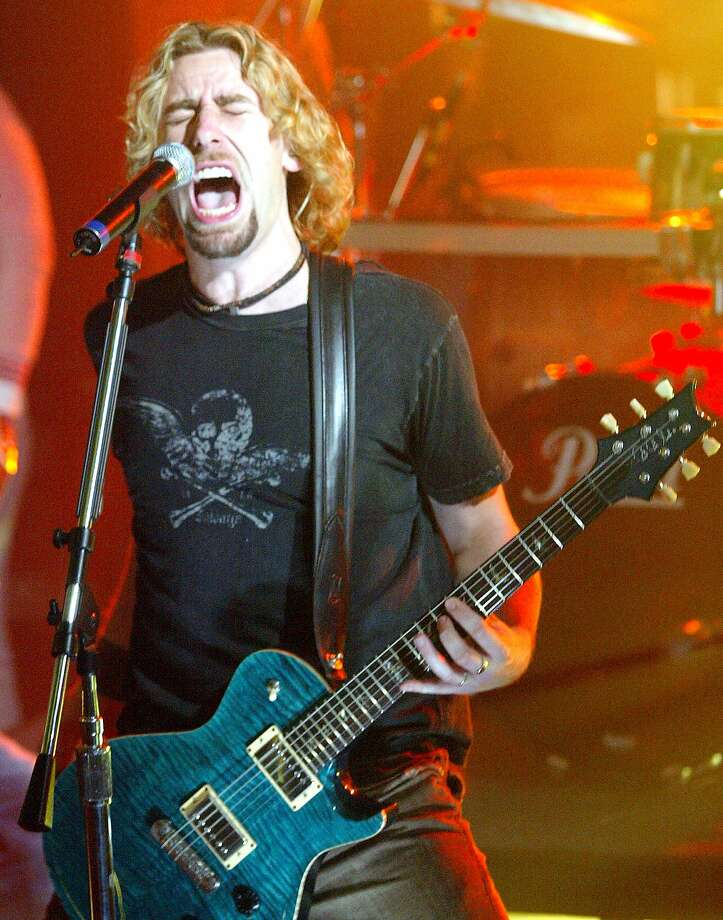 Fans listen as Nickelback's lead signer Chad Kroeger performs live at Much Music on Thursday, Oct. 13, 2005 in Toronto, Ont. Photo: NATHAN DENETTE, AP
