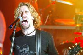 Fans listen as Nickelback's lead signer Chad Kroeger performs live at Much Music on Thursday, Oct. 13, 2005 in Toronto, Ont. Toronto was one of many stops across Canada during the group's one day tour. (AP Photo/Nathan Denette)