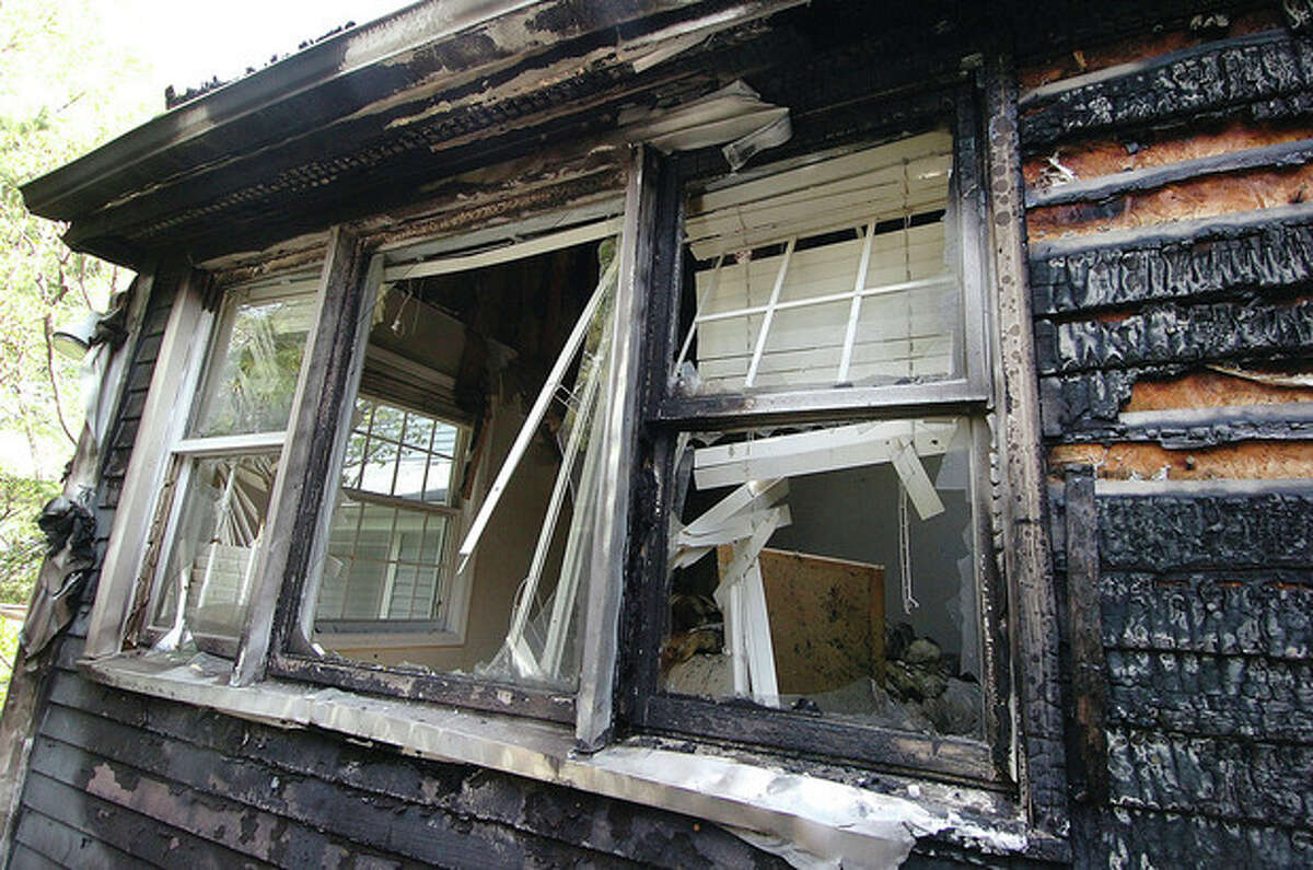 Hour Photo/ Alex von Kleydorff. A set of windows at the Wilton Crest condo that burned on Sunday.