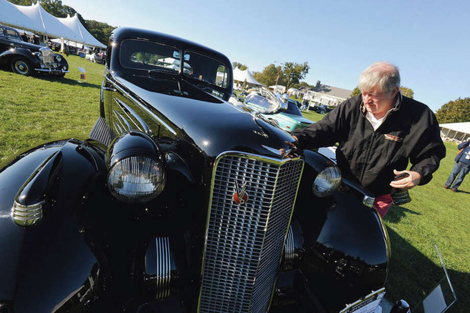 Hour photo / Matthew Vinci Owner Dave Kane shines up his 1937 Cadillac V-16 Stationary Coupe Sunday in Westport. / (C)2011, The Hour Newspapers, all rights reserved