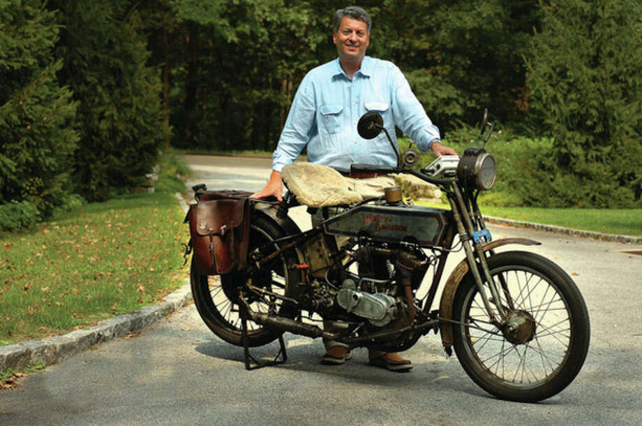 Hour Photo/ Alex von Kleydorff. Buzz Kanter and his 1915 Harley Davidson Twin, he will ride in the Nutmeg Tour for Autism and enter in the Fairfield County Concours d'Elegance this weekend in Westport. / 2011 The Hour Newspapers/ Alex von Kleydorff
