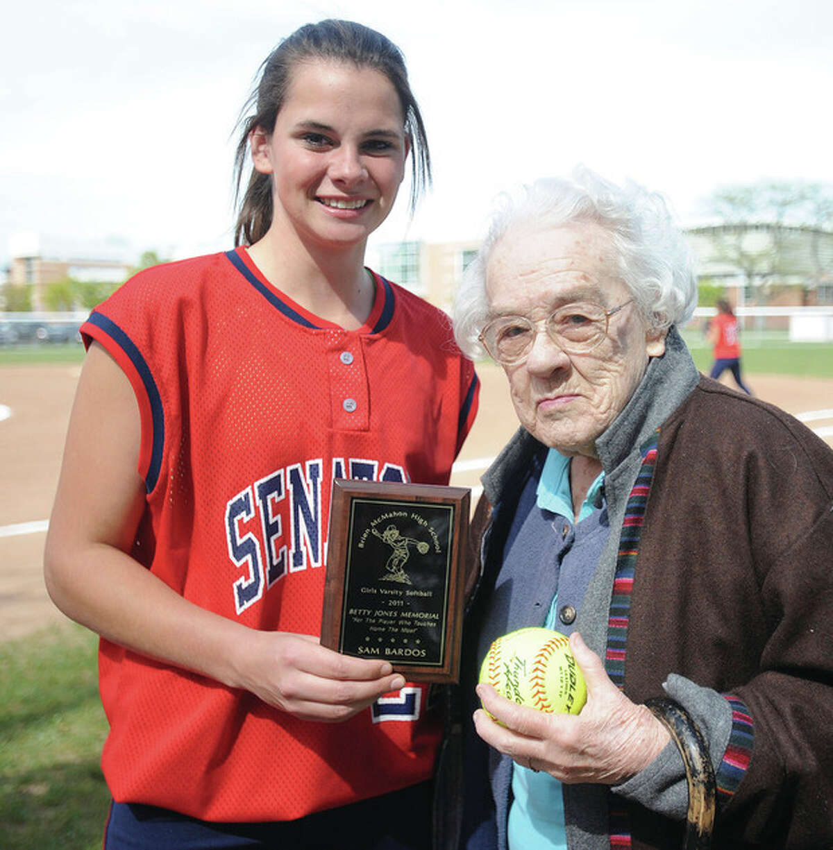 Betty Jones of Norwalk, right, stands with Brien McMahon softball player Sam Bardos, who is holding on to the first-ever Betty Jones Award, which she won last year for scoring the most runs. The Senators play on a field that was built on the site of Jones life-long home, which was taken from her by the city by an act of eminant domain.