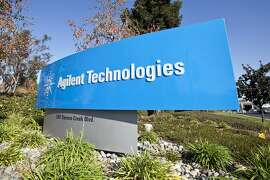 Signage is photographed outside the headquarters of Agilent Technologies Inc. prior to a dedication ceremony for a SunPower Corp. solar panel array atop Agilent's headquarters in Santa Clara, California, U.S., on Thursday, Nov. 19, 2009. SunPower Corp., the second-biggest U.S. supplier of solar modules, will meet its goal to reduce production costs to below $1 per watt by 2014, the company said last month. Photographer: Chip Chipman/Bloomberg