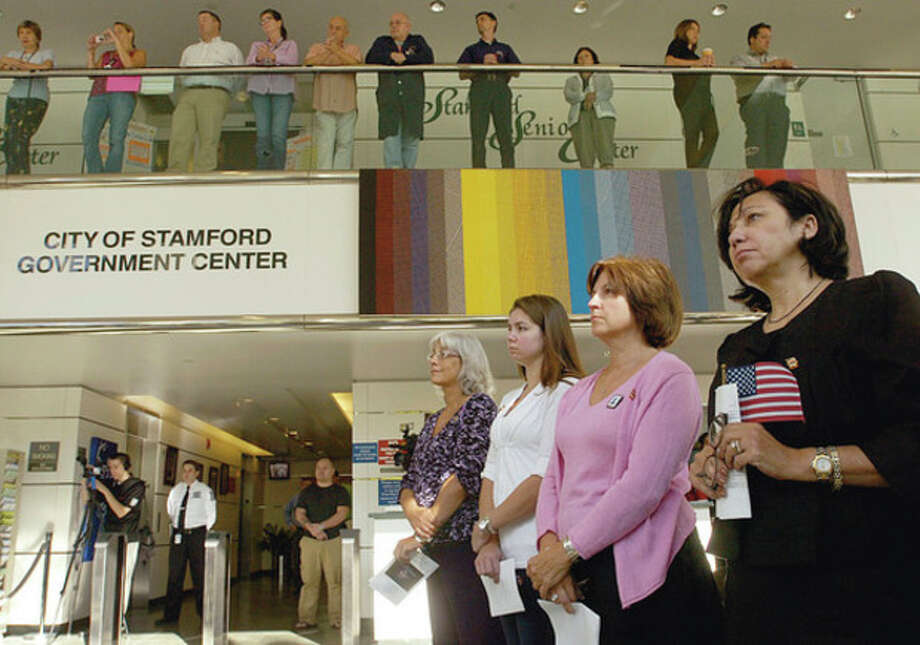 Relatives of Stamford victims of the World Trade Center attacks, at lower left, Donna Hughes, Rebecca and Denise Scott and Anna Egan attend the Ceremony to Commemorate The Tenth nniversary of September 11, 2001 at the Stamford Government Center Friday morning. / (C)2011, The Hour Newspapers, all rights reserved