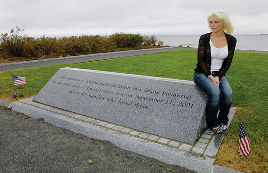 Ashley Gilligan reflects on September 11th 2001 at Sherwood Island State Park 9/11 Memorial. Her father Ronald was killed at the World Trade Center on that day. / ©2010 The Hour Newspapers