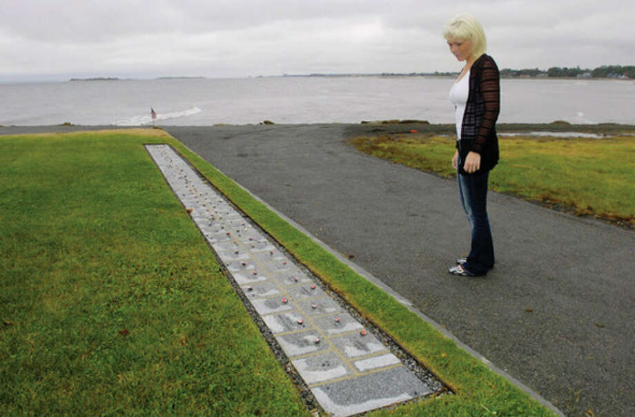 Ashley Gilligan reflects on September 11th 2001 at Sherwood Island Sate Park 9/11 Memorial. Her father Ronald was killed at the World Trade Center on that day. / ©2010 The Hour Newspapers