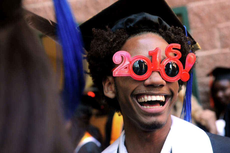 Timothy Graham, an Aerospace/Hydrospace Engineering & Physical Sciences graduate from Bridgeport, takes part in the First Annual Commencement for The Interdistrict Science Magnet Schools at the Fairchild Wheeler Campus, held at the Webster Bank Arena in Bridgeport, Conn. June 14, 2016. Photo: Ned Gerard, Hearst Connecticut Media / Connecticut Post